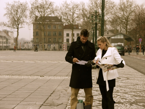 Couple lost in Bruges Square